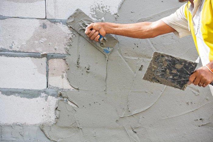 Гипсовая и цементная штукатурка на стенах