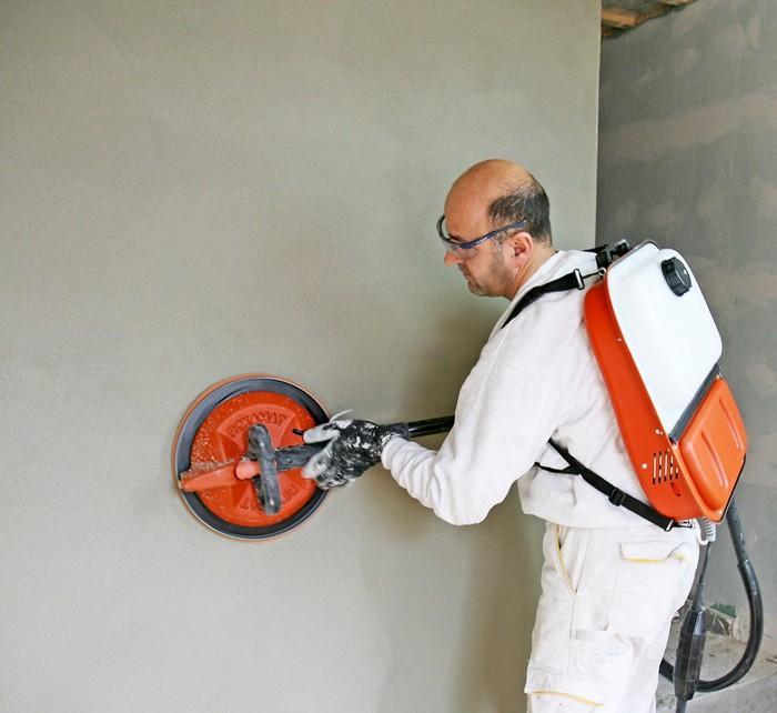 Машинка для затирания штукатурки используется для шлифовки стен и потолков