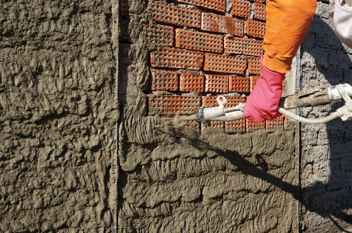 Машинная штукатурка фасадов производится только с применением цементно-песчаного раствора