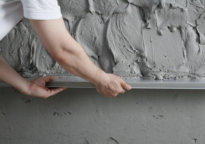 Штукатурка стен цементным раствором – наиболее доступный вид отделки