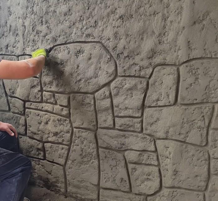 Декоративная штукатурка под камень требует навыков работы