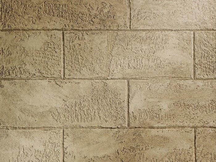 Для имитации каменной кладки применяют процарапывание линий с помощью стамески или острого края мастерка