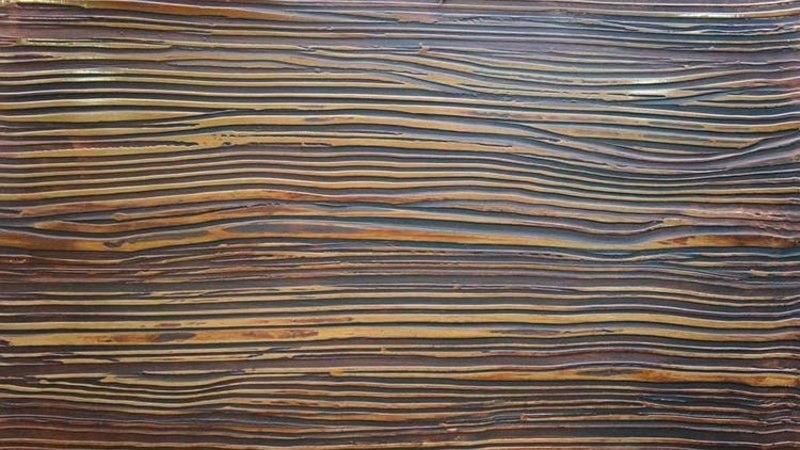 Декоративная штукатурка, имитирующая фактуру дерева, отличается небольшим расходом материала
